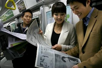 People reading on LG E-paper