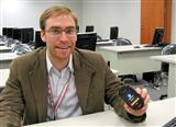 Sean Moss-Pultz, president of OpenMoko with a Neo 1973 handset