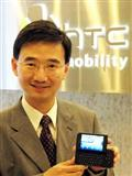 HTC CMO John Wang with a T-Mobile G1 handset