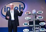 Shane Wall, VP of Intel's Mobility Group and Director of Strategic Planning, holding USI's MID 160