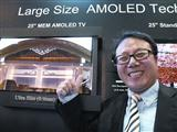 CMEL president Douglas Park showing its 25-inch AMOLED panel