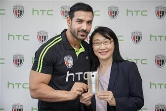 HTC+chairperson+Cher+Wang+and+NorthEast+United+FC+owner+John+Abraham