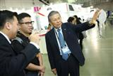 Yasuo Nishiguchi. right, chairman and CEO of Japan's IC designer Socionext