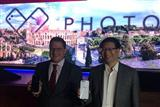 Asustek CEO Jerry Shen poses with Qualcomm executive vice president Christiano Amon in Roman