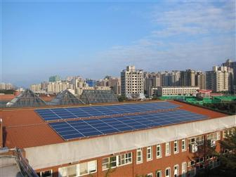 A rooftop PV system as part of a micro-grid in a large community