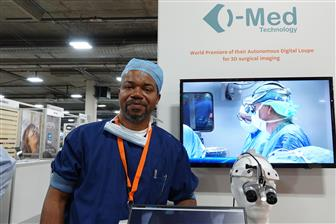 i-Med Technology CEO Vincent Graham and 3D digital surgical head-mounted loupe (at his left)