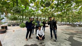 Hugreen founder and CEO Clement Lee (standing front right)