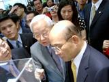 TSMC chairman Morris Chang shows 300mm wafer technology at SemiTech