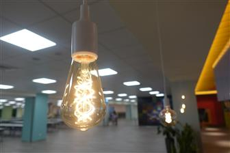 An LED filament light bulb