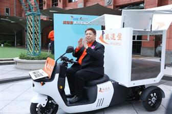 Adata Technology chairman and CEO Simon Chen rides an in-house-developed electric tricycle
